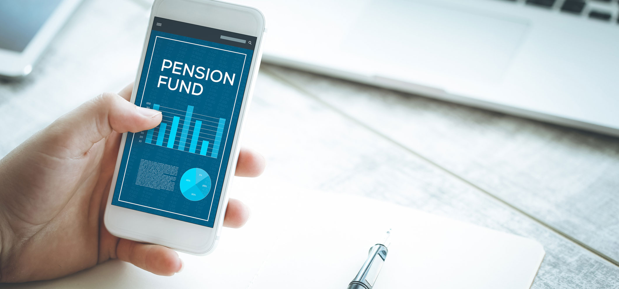 Holding Phone with the phrase 'Pension Fund' on it